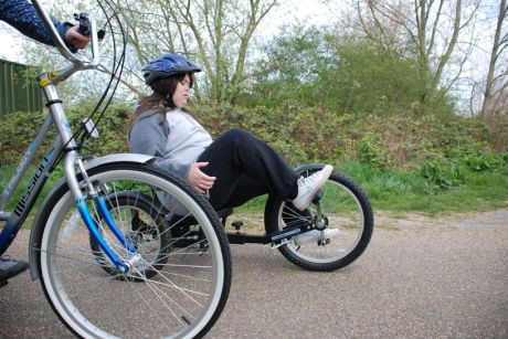 The Camden Society Bike Club rider takes a three wheeler recumbent cycle for a spin