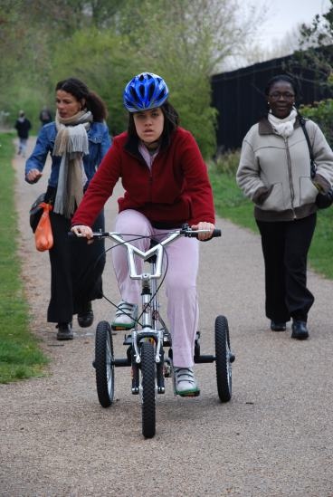 Young person riding a trike from the Camden Society Bike Club